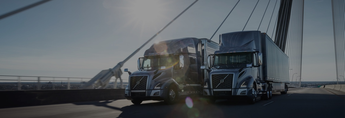 two Volvo Trucks VNL model on a hanging bridge -full-width-teaser