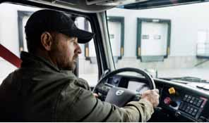 a person with cap inside a Volvo Truck - Blog