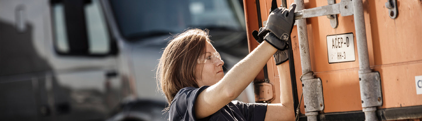 a Lady working on a Volvo Truck