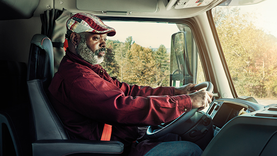 driver in a Volvo Truck cabin for News-Stories