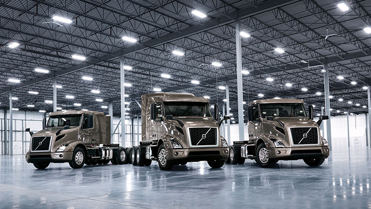 Three Volvo Trucks VNR standing for photo shoot