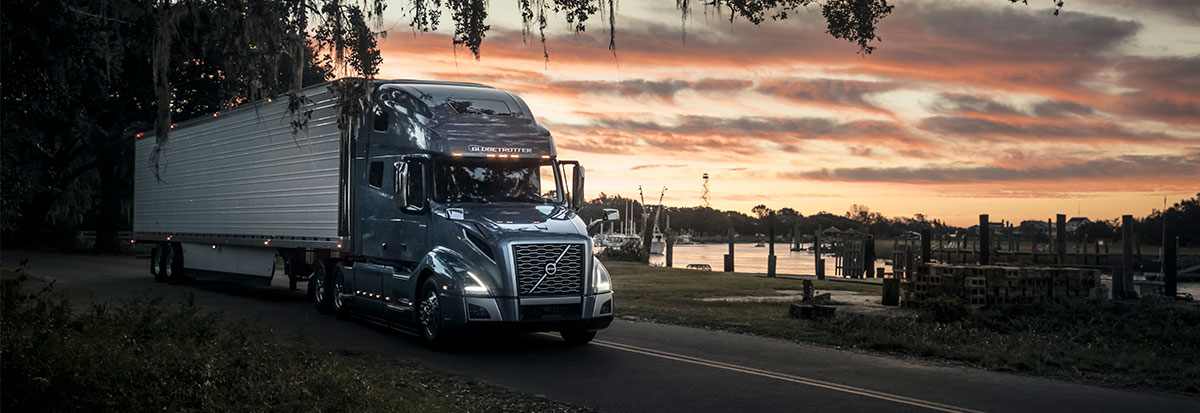 Volvo Trucks VNL carrying a container -Hero