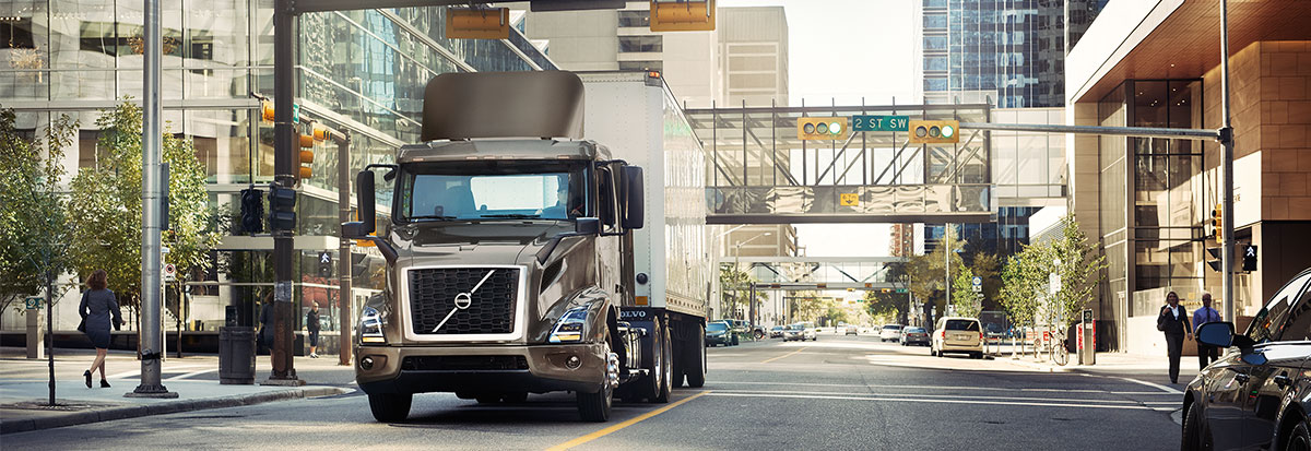 Volvo Trucks VNR carrying a container in a Urban road-Hero