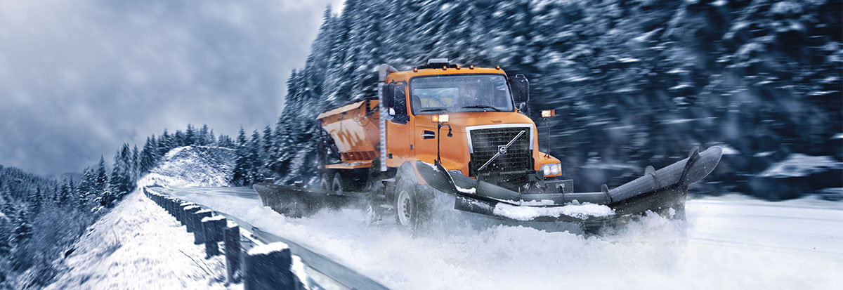 Volvo Truck clearing snow covered road - Plow_Hero