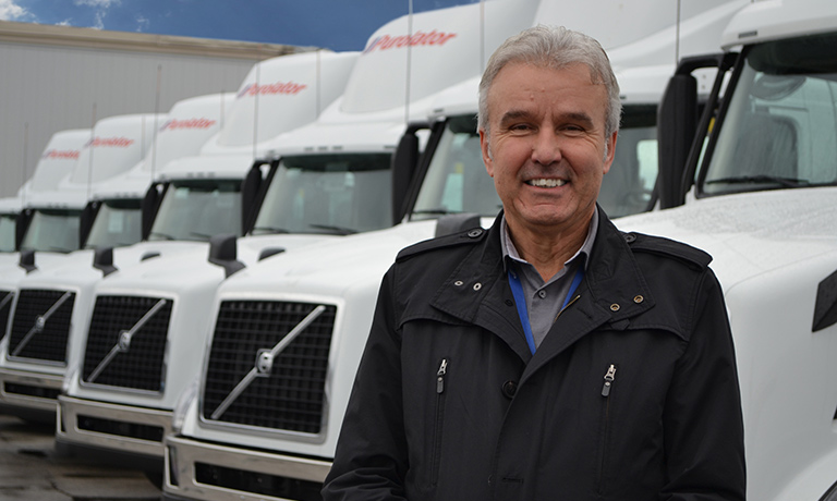 Volvo Trucks Delivers First Canadian Models equipped with 2017 Engines to Purolator Serge-Viola Director of asset management