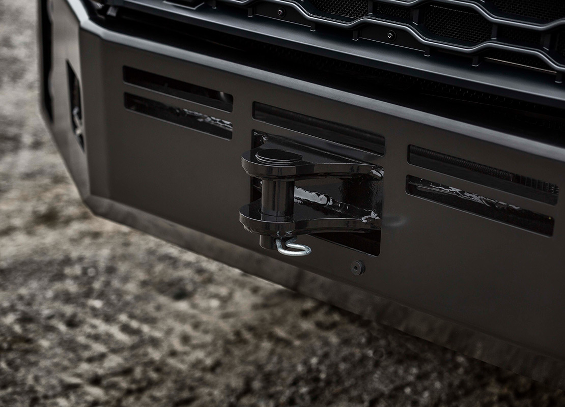 Rugged VNX bumper features a heavy-duty tow pin and center tow fram