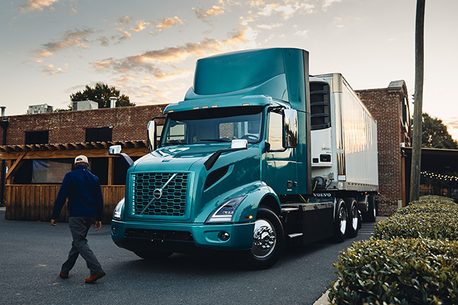 Volvo VNR Electric Parked with Driver Walking